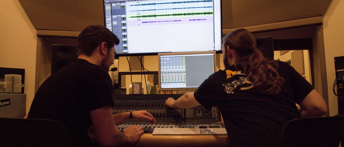 Music students working in recording studio